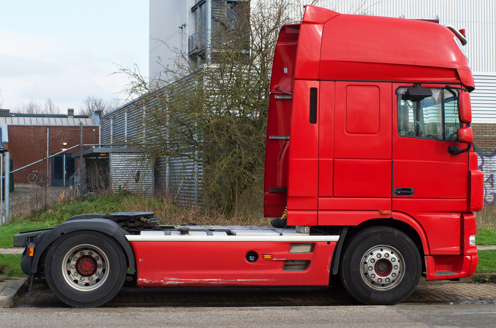 Red haulage truck without semi trailer